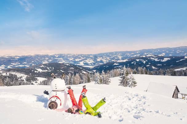 Der Schneemann und wir am Klippitztoerl